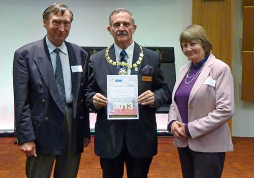 AVDC leader Cllr Derick Isham giving the certificate to Bob and Judy Lewis