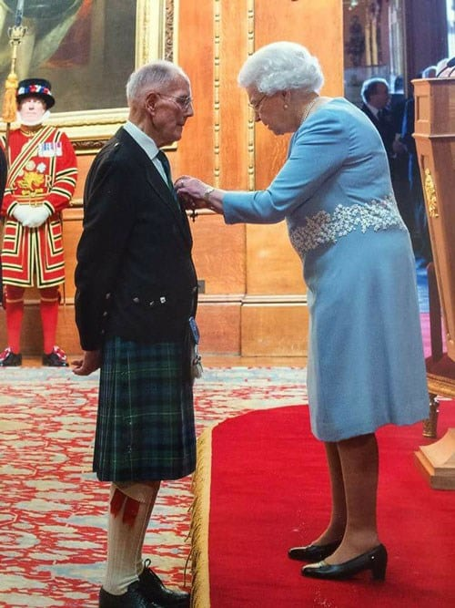 Dr Campbell receiving his MBE from HM Queen Elizabeth II in March 2015