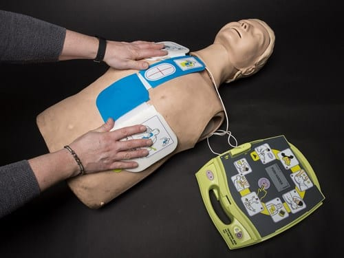 Demonstrating pad placement with an AED