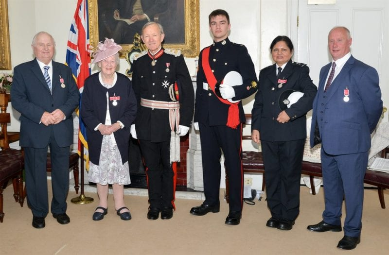 British Empire Medal holders with Sir Henry Aubrey-Fletcher, from left John Cornish, Joyce Brooker, Sir Henry Aubrey-Fletcher, Lord Lieutenant Sea Cadet Sam Keating, Manju Rajawat and Terry Ridgley