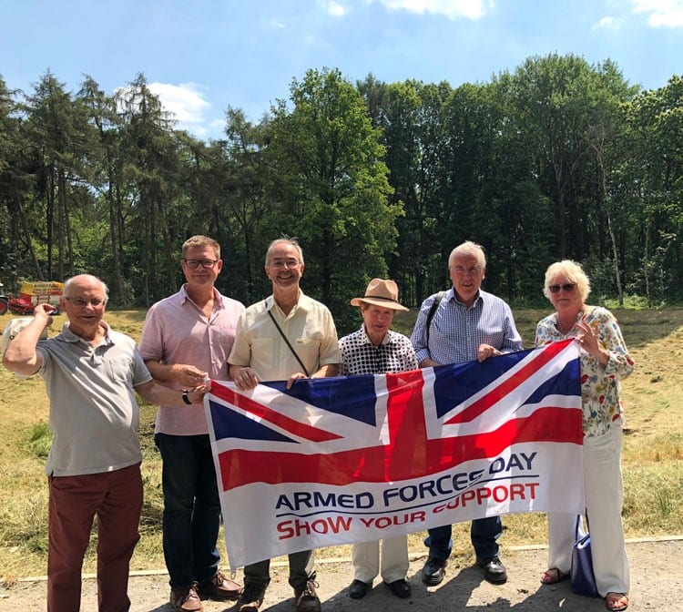 The BCC delegation by the Caterpillar Mine Crater near Hill 60 close to Zillebeke. From left: Mike Appleyard, Steven Lambert, Martin Tett, Netta Glover, Brian Roberts and Lin Hazell holding the Armed Forces Day flag.