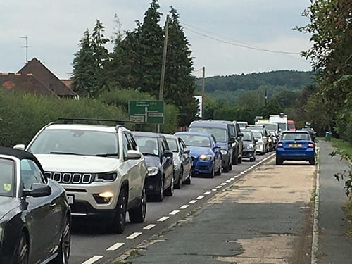 Traffic buildup caused by HS2 investigative work along the A413 in Wendover, evening rush hour, 23 August 2018.