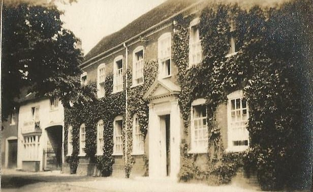 Home of Arthur Philbey and family, left of archway. Home of Dr Orme and family on right, now called The Red House, Aylesbury Road.
