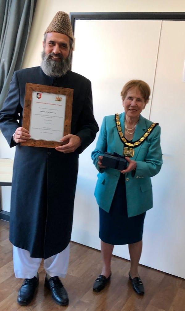 Chairman Netta Glover presents a Service to the Community Award to Imam Arif Hussain
