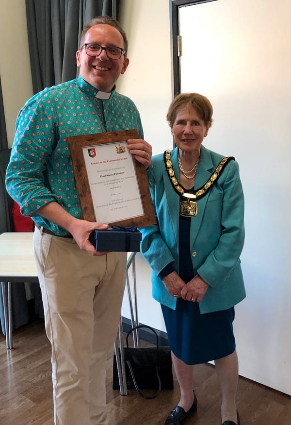 Chairman Netta Glover presents a Service to the Community Award to Revd Simon Cansdale. Images courtesy Buckinghamshire County Council.