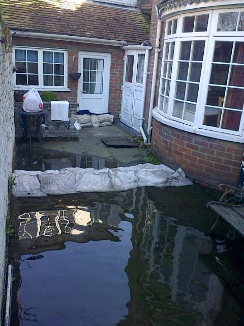 Sandbags protect a home in Pednormead End from flood water in 2014