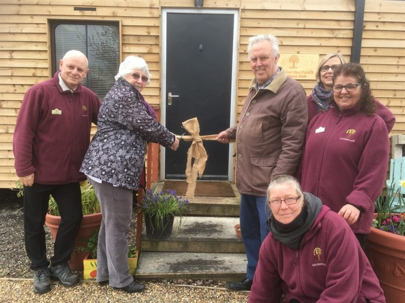The cutting of the hessian ribbon ceremony shows from left to right: Phil Chattle, Chair of  Lindengate Trustees; Marion Clayton and Robert Duggan Trustees of Lionel Abel-Smith Trust; Diane Kolonko, Volunteer Manager at Lindengate; Jan Webster, Director of Lindengate; Charlie Powell, Co-Founder and Site and Horticultural Manager at Lindengate.
