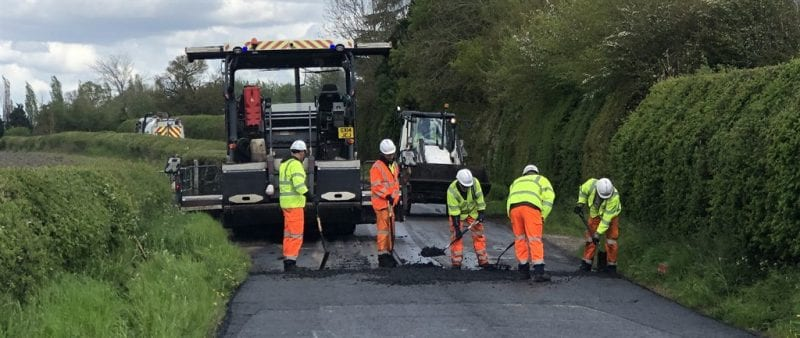 Resurfacing team work on a stretch of road at Slapton