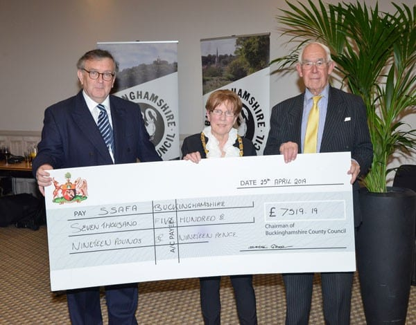 Chairman Netta Glover, accompanied by Judge Francis Sheridan, presents a cheque to John Stevens from SSAFA Buckinghamshire.