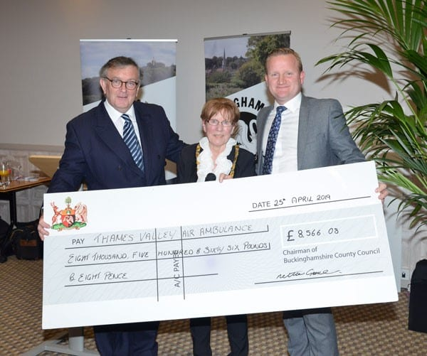 Chairman Netta Glover, accompanied by Judge Francis Sheridan, presents a cheque to Neil Harman, Director of Thames Valley Air Ambulance. Images courtesy Buckinghamshire County Council.