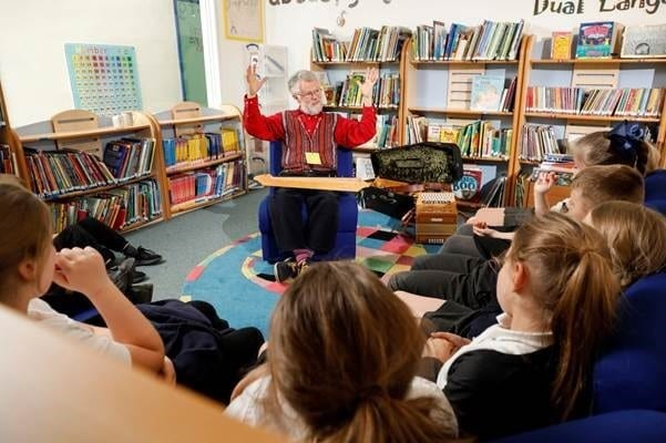 Pupils at Broughton Fields Primary School having stories told by storyteller, Richard York