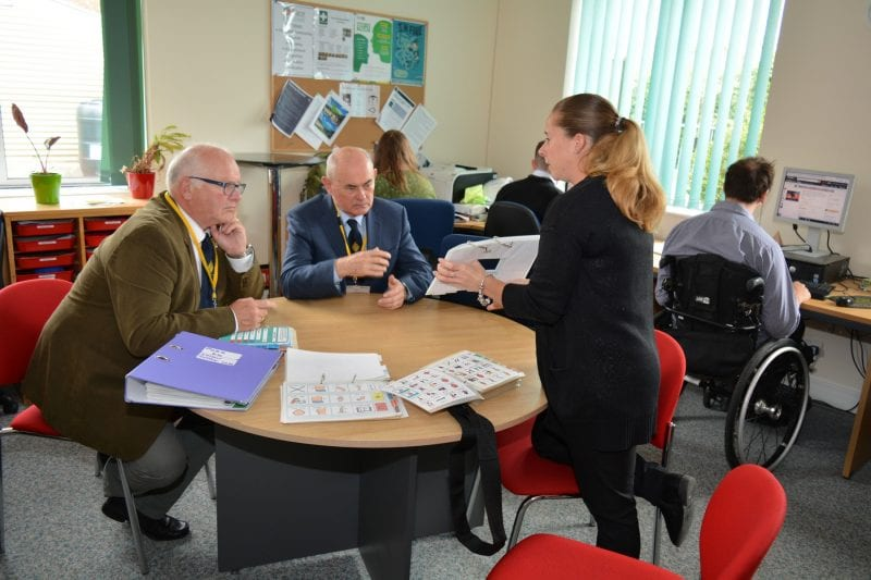 BMCF Secretary Andrew Hough, Bucks AGPM Phil Blacklaw receiving an explanation of the PODD system by Speech and Language Therapist Amy Bennett