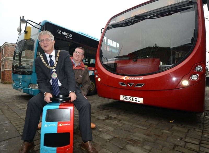 Partnership ride: Mark Shaw Buckinghamshire County Council Deputy Leader and Transport Cabinet Member, and Wycombe District Council Chairman Paul Turner demonstrate the Arriva and Carousel partnership bus model