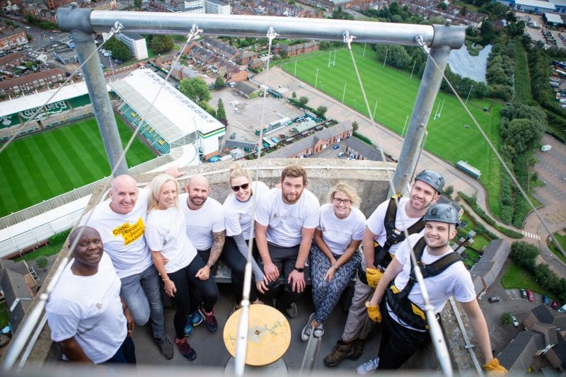 The David Wilson Homes representatives at the top of the tower after completing the abseil for Cystic Fibrosis Trust