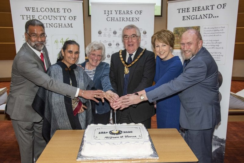 Cake cutting: Chairman Brian Roberts with his wife, Margaret; Vice Chairman Dev Dhillon (left) and his wife, Kuldip; and longest-serving county councillor Bill Chapple OBE (right) and his wife, Sue