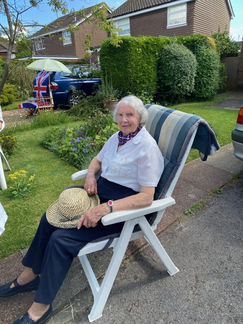 Margaret Seabrook enjoying VE-75 celebrations while distancing from neighbours