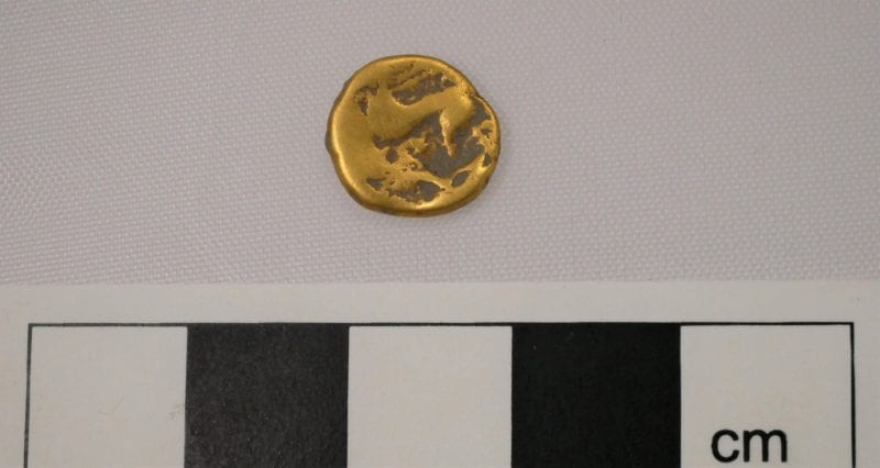 This Iron Age gold coin called a stater was found near the funerary monument.