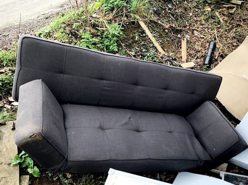 Blot on the landscape: the dumped sofa sits with waste already dumped in the ditch
