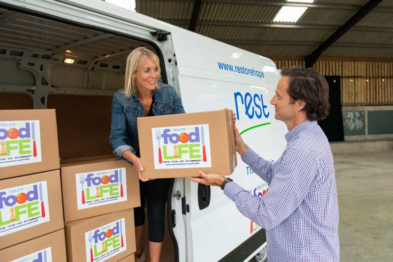 Graham and Joanna Wakeman load the first food parcels into the new vehicle