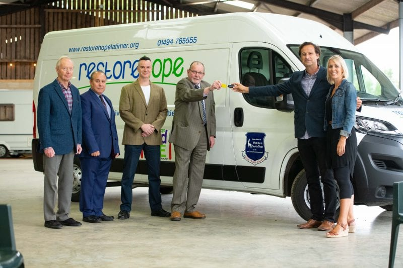 Mike Humphreys hands over the 100th van to Graham Wakeman the Director of  Restore Hope and his wife Joanna who is Worship and Prayer Director. Accompanying Mike are (left to right) Trust Directors, Paul Miller, Richard Minashi and Matthew Humphreys.