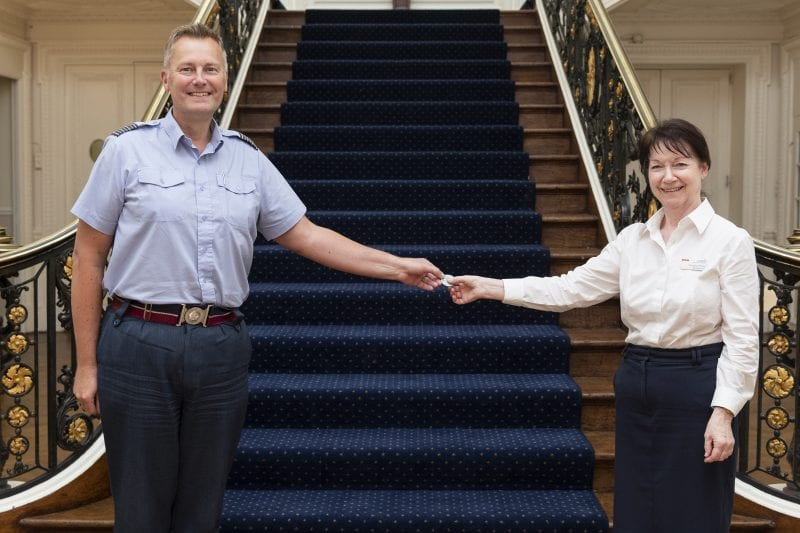 Stn Cdr Startup hands out Coins to RAF Personnel (Civilian and RAF) to say Thank you for service. Georgina Pretty recieves the coin for her work at Halton House.
