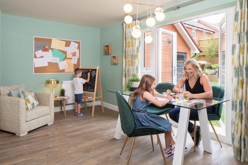 Family enjoying a Barratt Homes kitchen