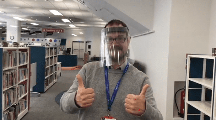 Library staff member wearing PPE