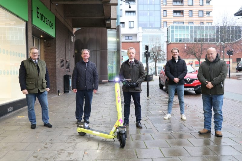 Aylesbury MP, Rob Butler (centre) checks out the new electric scooters with (L-R) Clive Harriss, Cabinet Member for Sports and Leisure; Steve Bowles, Cabinet Member for Town Centre Regeneration, Will O'Brien and Peter Gomez from operators, Zipp Mobility.