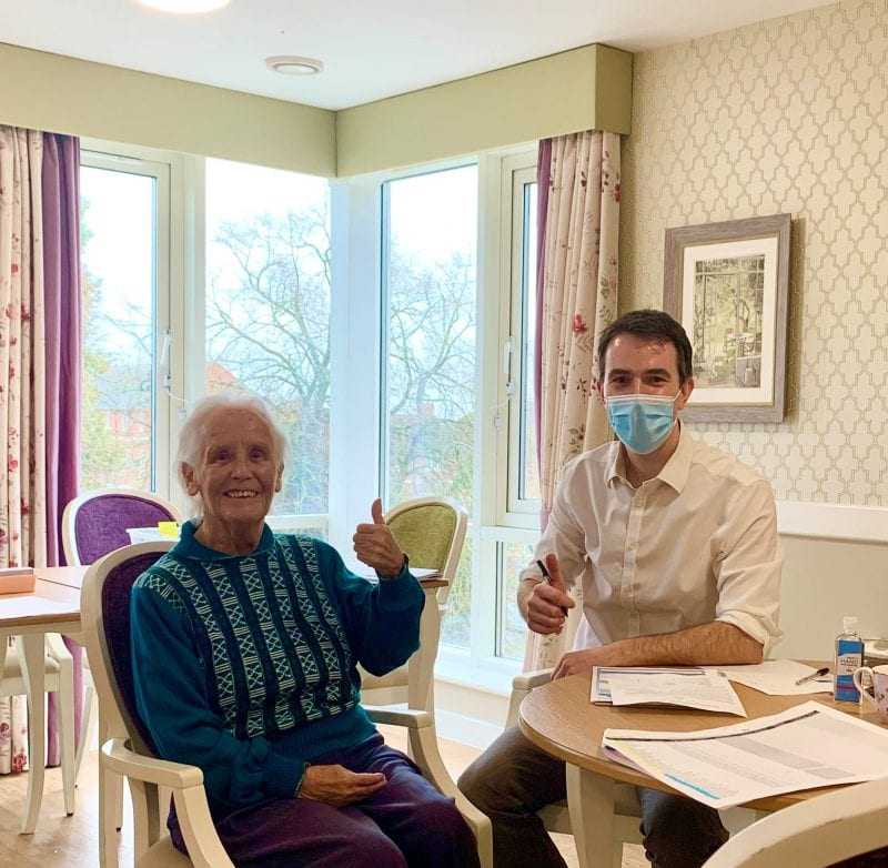 Jean - Resident at Hampden Hall Care Centre recieves her first COVID vaccine from Dr Mike Thomas