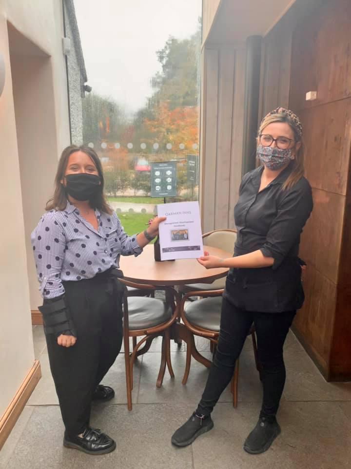 Great Missenden - Polecat Inn Georgia Price congratulates Hanna Howard on Trainee Assistant Manager post - copyright Oakman Group